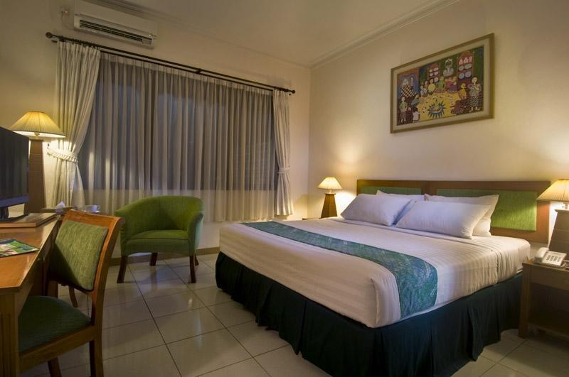 Griya Sentana Hotel Yogyakarta - kamar yang luas dan interior ruang yang modern membuat istirahat anda lebih nyaman