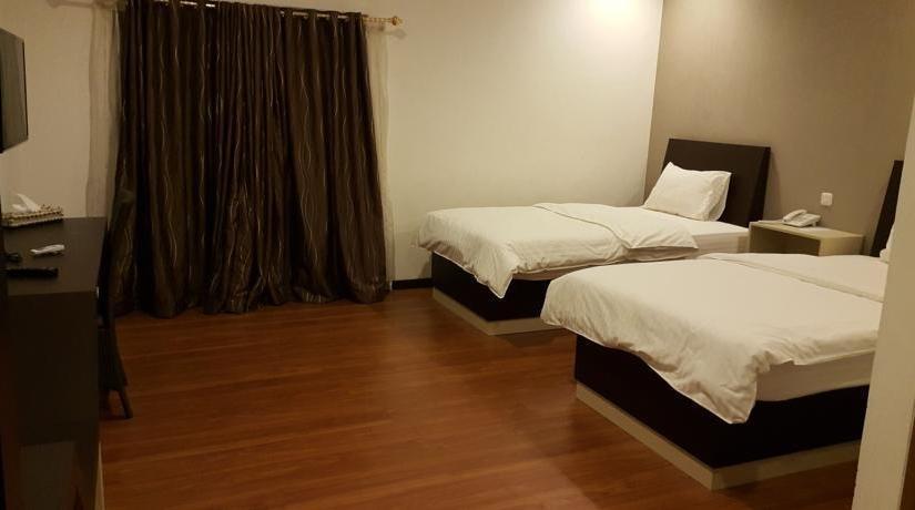 Kampoeng Nelayan Hotel Palu - Kamar tamu