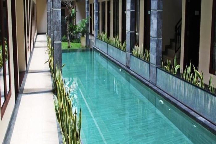Delapan Unit Villa Didesain Secara Modern Dan Aman Setiap Menghadap Kolam Renang Pribadi Di Taman Bergaya Khas Bali Yang Indah Perabotan Elegan