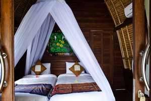 Lotus Garden Huts Bali - Bedroom