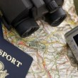 623782-two-passports-ready-for-the-next-vacation-the-camera-and-binoculars-are-ready