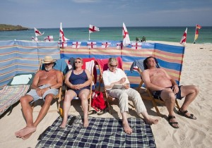World cup England supporters sunbathing on the beach at St Ives, Cornwall, UK.