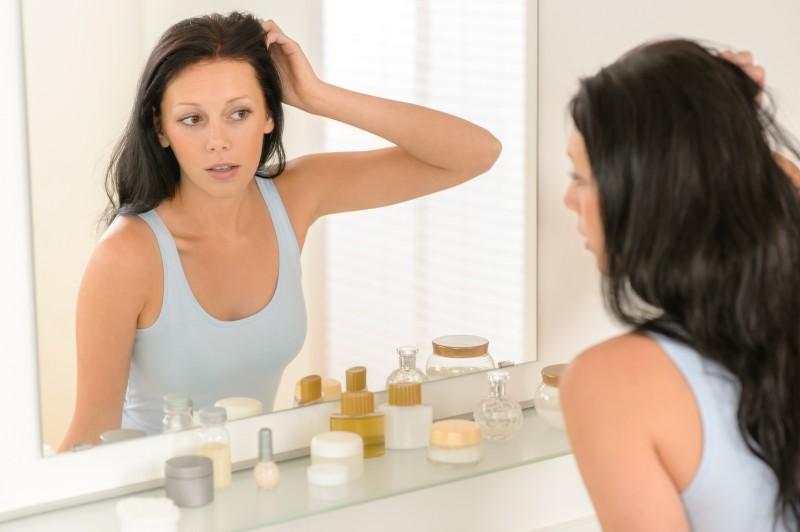 Woman look at herself bathroom mirror reflection