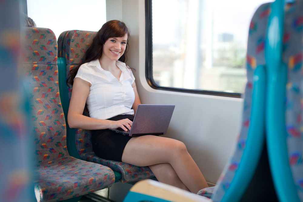 Young businesswoman working on the train